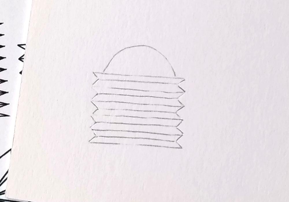Das Motiv ist fertig durchgepaust als Bleistiftkontur auf dem Blatt.