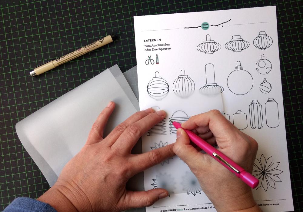 Durchpausen des Motivs auf das Transparentpapier mit einem weichen Bleistift.